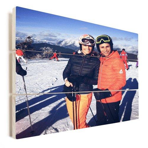 Foto auf Holz Pärchen im Schnee